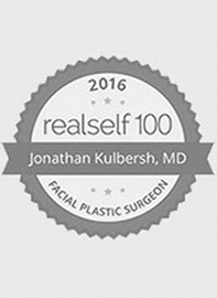 Realself logo for their top 100 hall of hame award present to Dr. Kulbersh in 2016