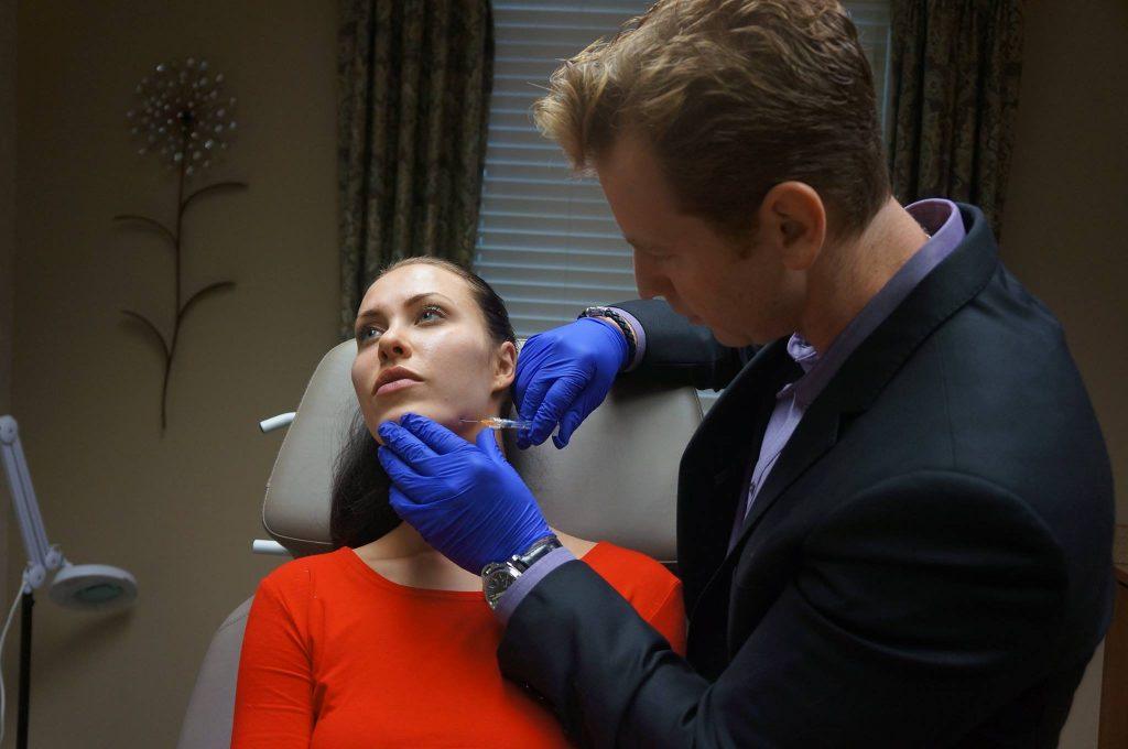 Dr. Kulbersh treating patient