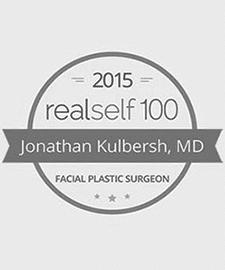 logo RealSelf por su parte superior 100 Premio del Salón de Hame presente al Dr.. Kulbersh en 2015