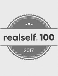 logo RealSelf por su parte superior 100 Premio del Salón de Hame presente al Dr.. Kulbersh en 2017