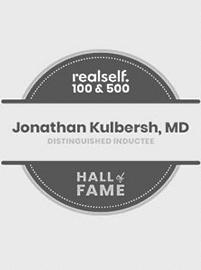logo RealSelf por su parte superior 100 y la parte superior 500 Premio del Salón de la fama por el Dr.. Kulbersh's Charlotte plastic surgery center